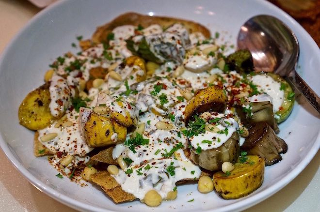 Mamnoon-Fatteh-chickpea-spring-green-yogurt-pine-nuts-brown-butter-squash-zucchini-eggplant-credit-Amber-Gibson